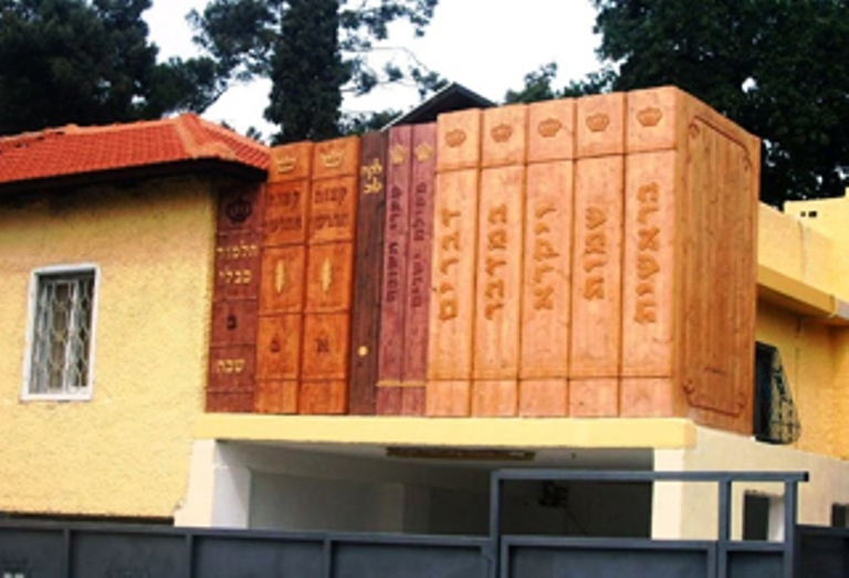 Huge wooden books above parking