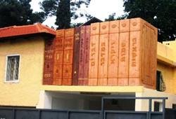 Huge wooden books above parking
