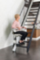1100-woman-sitting-stairlift-looking-awa