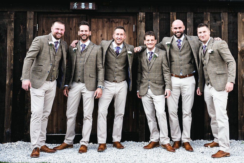 The groomsmen in their suits