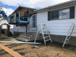 Removing existing siding to update your home's look.