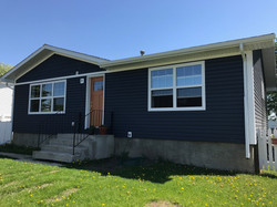 New vinyl siding and a cleverly painted front door makes a home look brand new!