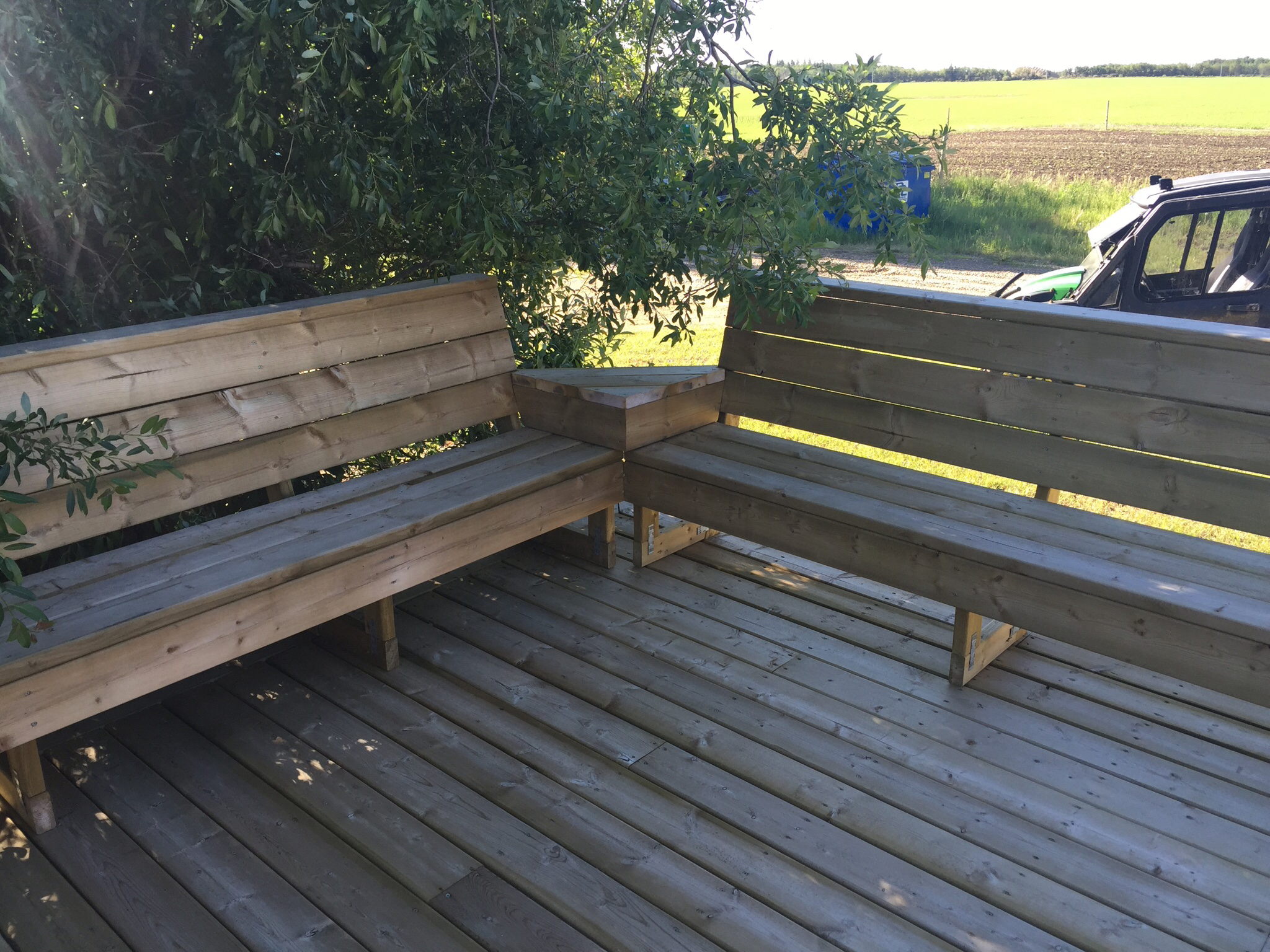 Seats on deck are a convenient alternative to railing.