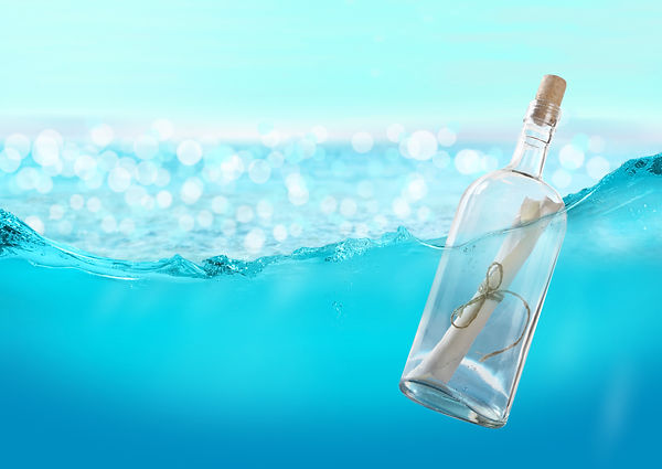 Bottle with a message in the water..jpg