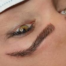 Close-up of nano brow strokes.