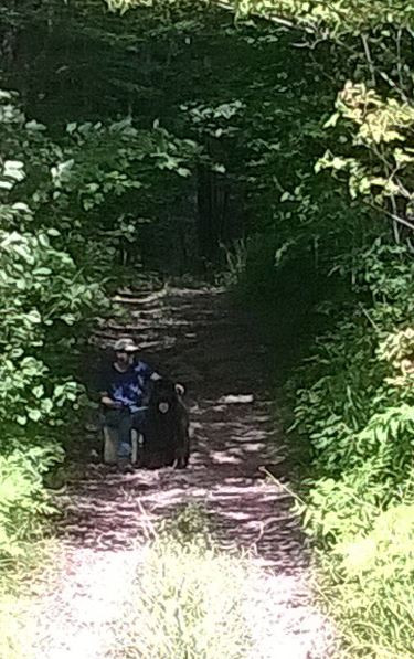 Tim and Nash taking a break on the hiking trail