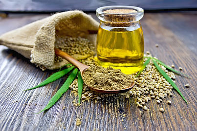 Flour hemp in a wooden spoon, seed in a