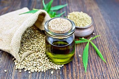 Hemp oil in a glass jar with flour in a