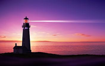 Lighthouse searchlight beam through mari