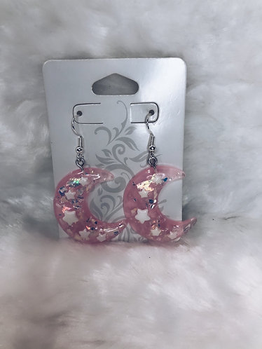 Two pairs of moon resin earrings pink and green