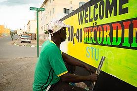 Micheal Robinson sign-painter Denham Town, in Kingston Jamaica