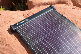 LightSaver Max Portable Solar Charger unrolled on a rock