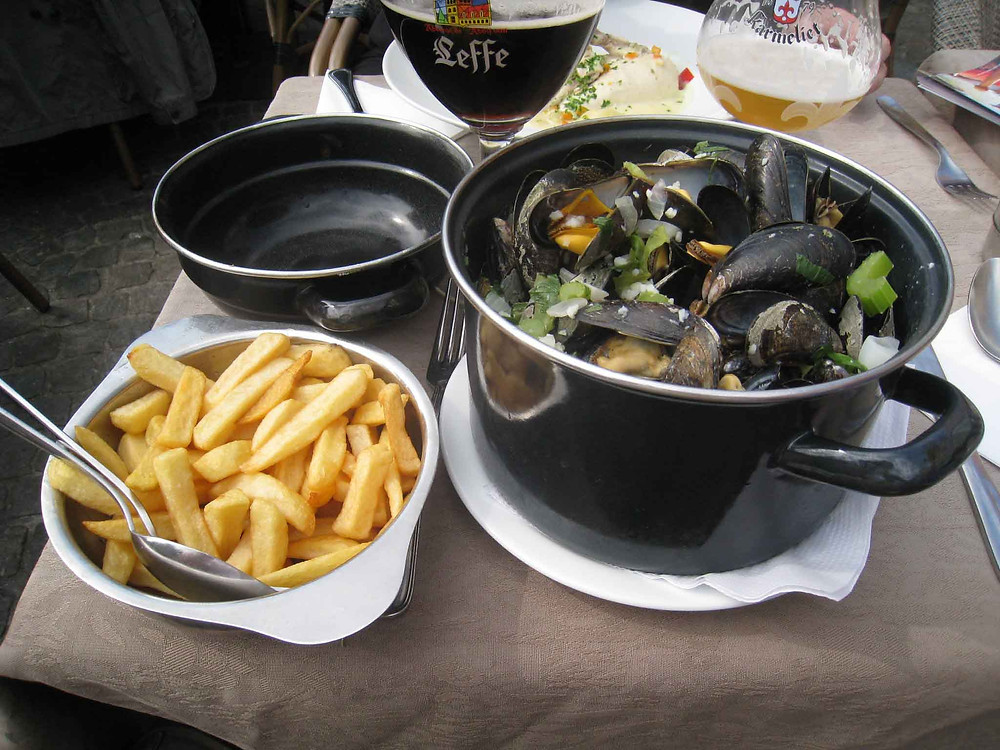 The most common menu or dish for mussels, fries and a cold beer.