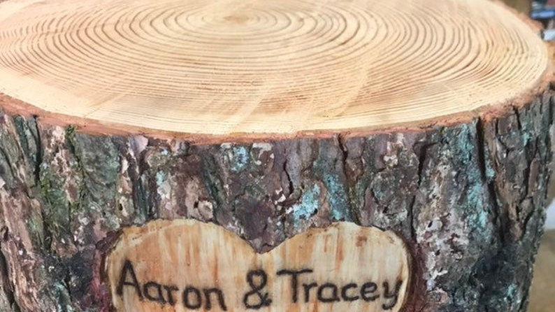 """Tall personalised rustic wooden log cake stand with carved out heart, 8"""" high."""