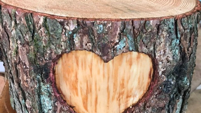 """Tall rustic wooden log cake stand with carved out heart, 8"""" high."""