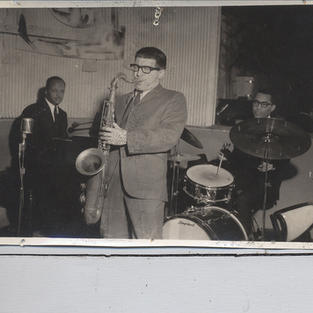 John Lewis on the drums performing with J.R. Montrose.