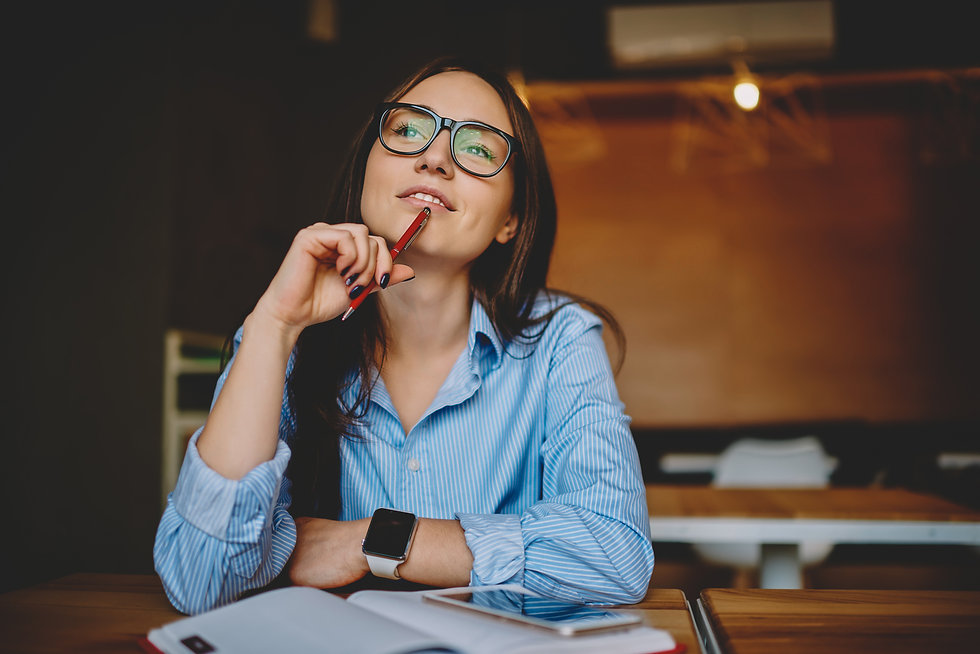 Thinking woman with pen.jpg