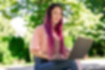 Nerdy Chick with colored hair on Park Bench with a Laptop. Obivously, a very happy client of Nerdy Chick Coaching, am I right?