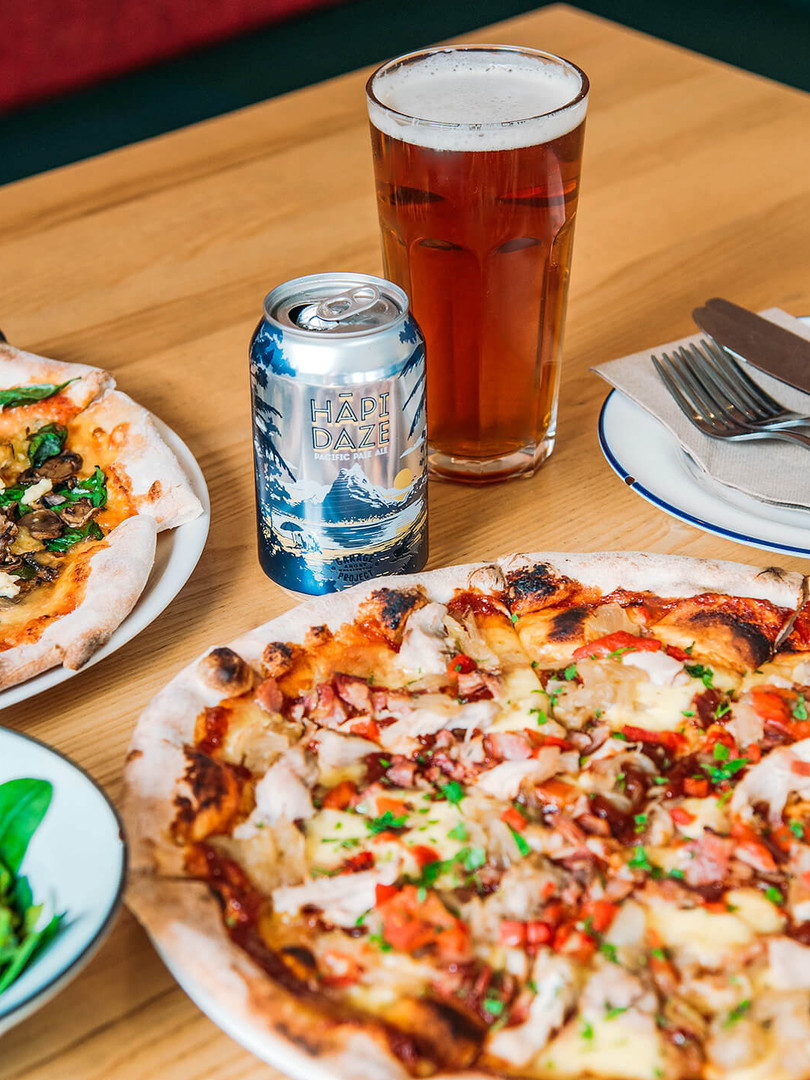 Pizzas and beer at Miss Lucy's