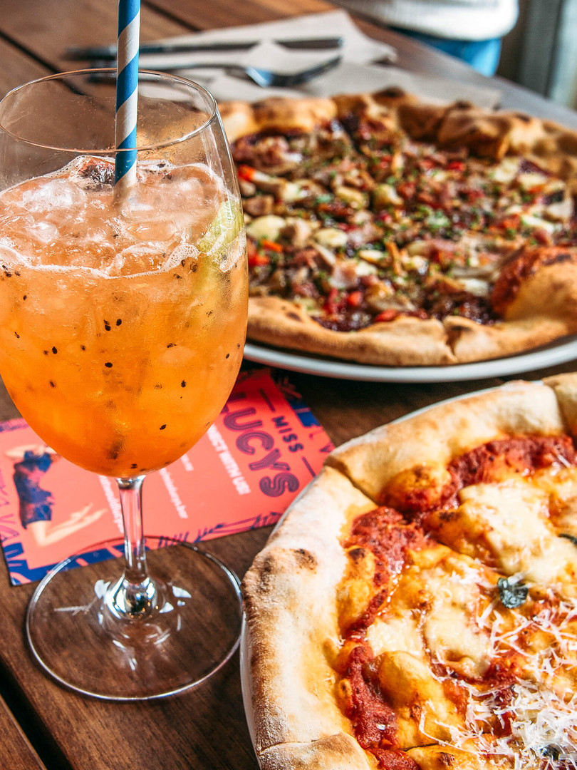 Pizzas and cocktail at Miss Lucy's