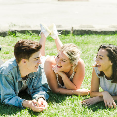 Friends lying down laughing.jpg