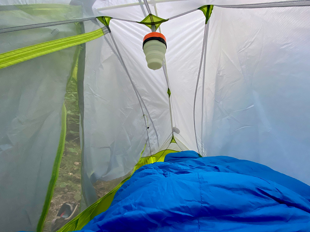 Photography taken from the inside of a tent