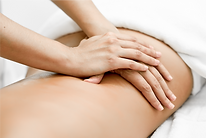 young-woman-receiving-back-massage-in-spa-center-WEB.png
