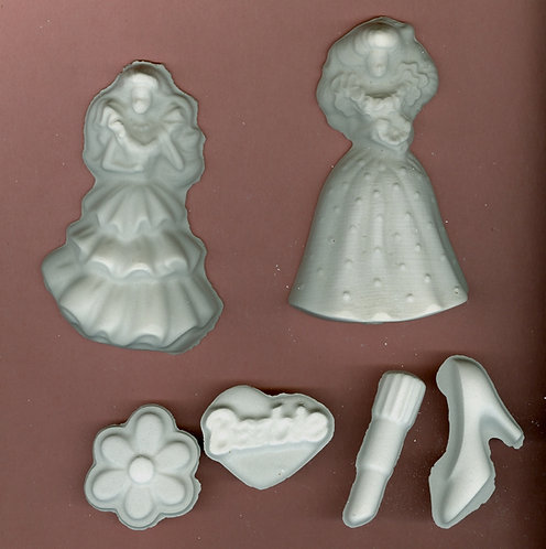Barbie doll with flower, lips, shoes plaster of Paris painting project.
