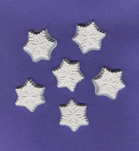 Traditional snowflake plaster of Paris painting project.