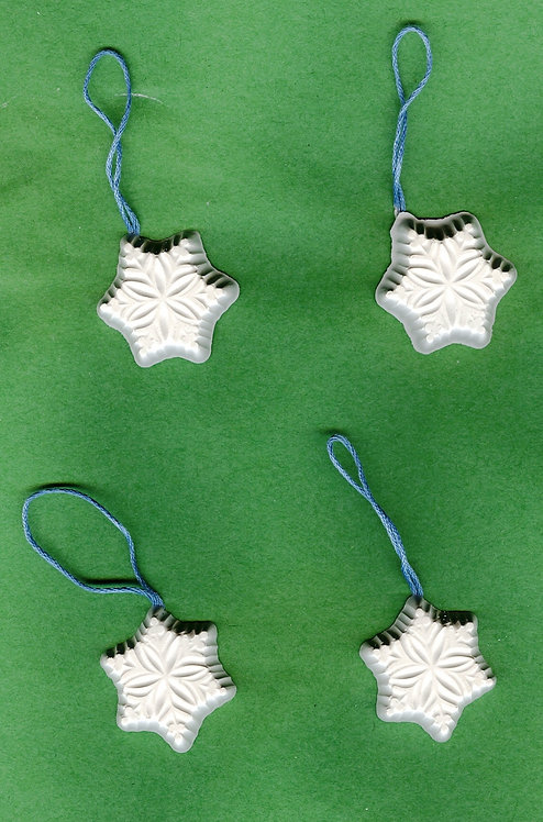 Traditional snowflake ornaments plaster of Paris painting project.