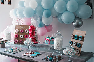 pink dessert table catering donut wall