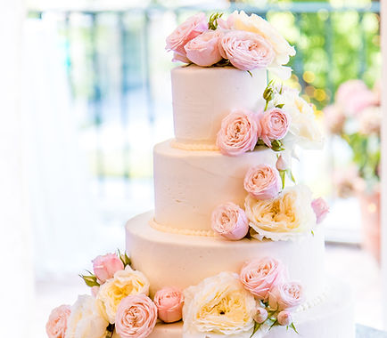 pink roses buttercream wedding cake