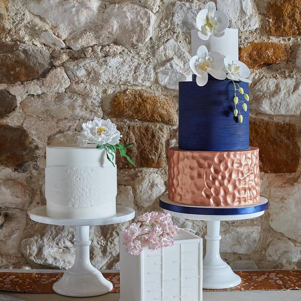 Rose gold textured wedding cake via Loveweddingcakes
