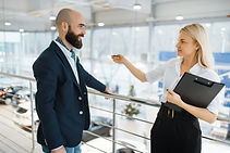 seller-invites-man-to-presentation-car-d