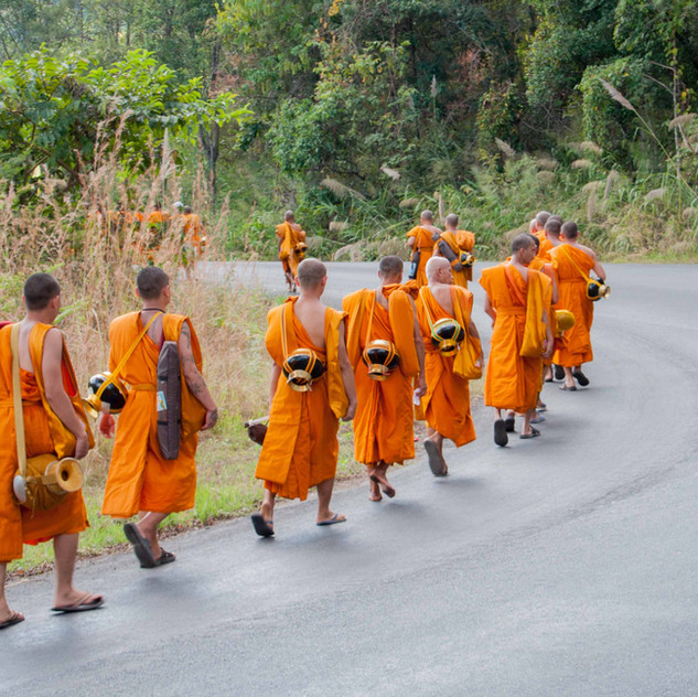 Monks on their way to receiving alms