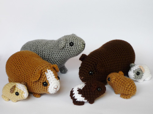 Family of knitted piggies