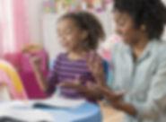 mother-helping-daughter-do-math-homework