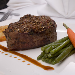 Three Peppercorn-Crusted Center-Cut Filet with truffle olive oil, duo au gratin potatoes and al dente sauteed spinach.