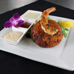 Grilled Jumbo Shrimp and Blue Cheese & Mushroom Risotto Croquette over Arugula