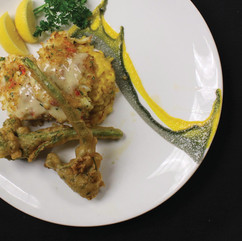 Crabmeat-crusted Redfish served over Saffron Risotto and Tempura Broccolini finished with a Mango Chutney