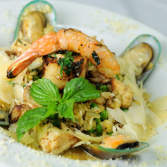 Pescatore Pasta: shrimp, calamari, clams, diced tomatoes and asparagus, tossed in a lobster sauce with cognac essence