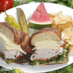 Turkey & Harvarti on Croissant with tomatoes, lettuce and cranberry mayonnaise.