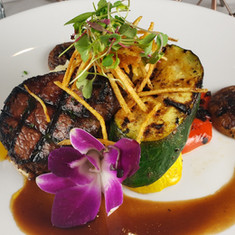 Filet Medallion served over Idaho whipped potatoes, grilled bell pepper, zucchini and squash, topped with a truffle merlot reduction and shoestring fries