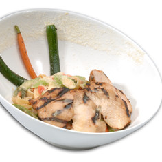 Grilled Chicken Piccata with Asparagus, Tomatoes, Mushrooms and capers, tossed in a bianco sauce.