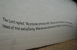 Foot steps in the sand poem on wall.jpg