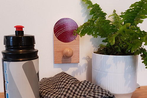 """Hand painted Cricket ball in solid Oak hook by """"Florence Ferne"""""""