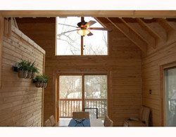 Log Home with lots of glass