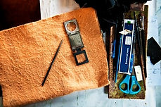 Etching tools: Intaglio needle, felt cloth and magnifying glass