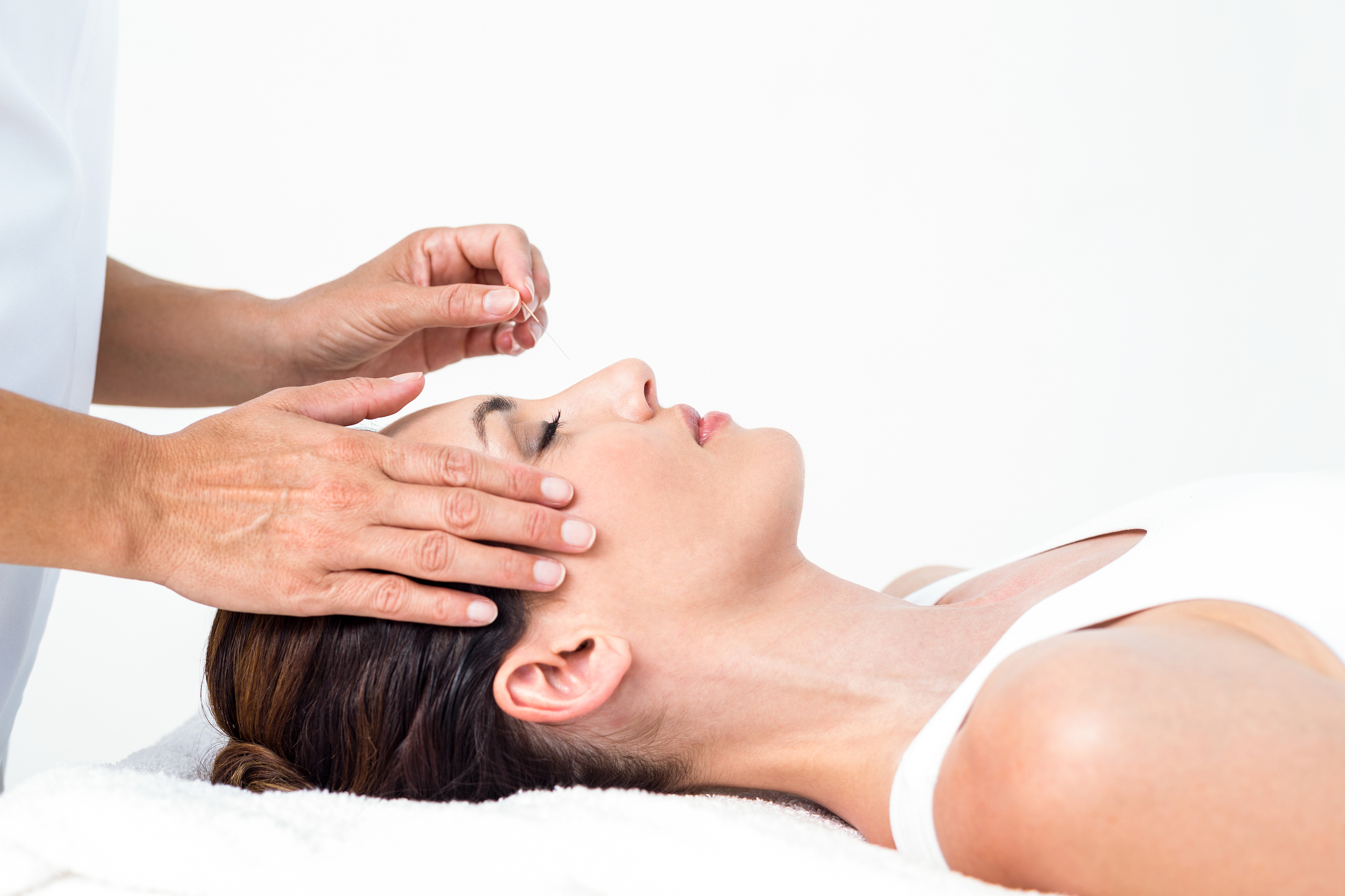 Relaxed woman receiving an acupuncture treatment in a health spa.jpg