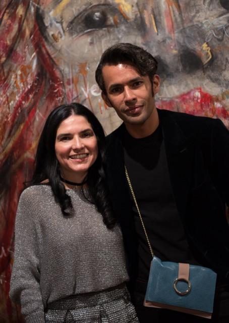 Rebeca Rösler con Jhan Carlo Torrenegra en el desfile en Begemot Art & Fashion Gallery